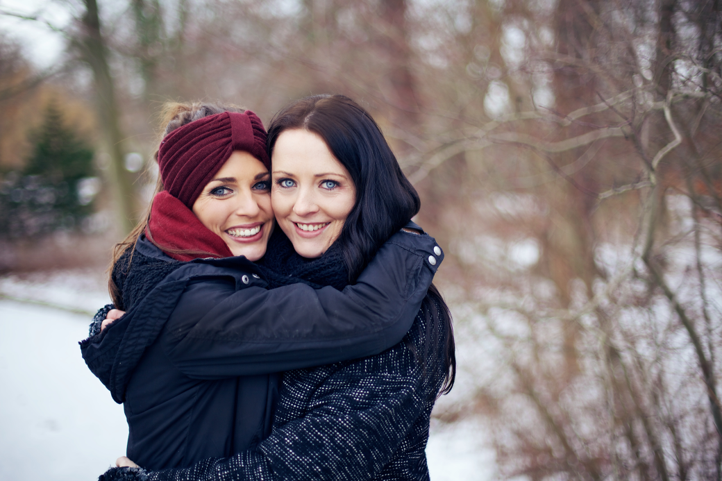 happy-friends-embracing-each-other-outdoors_H6g_8xIEtg.png