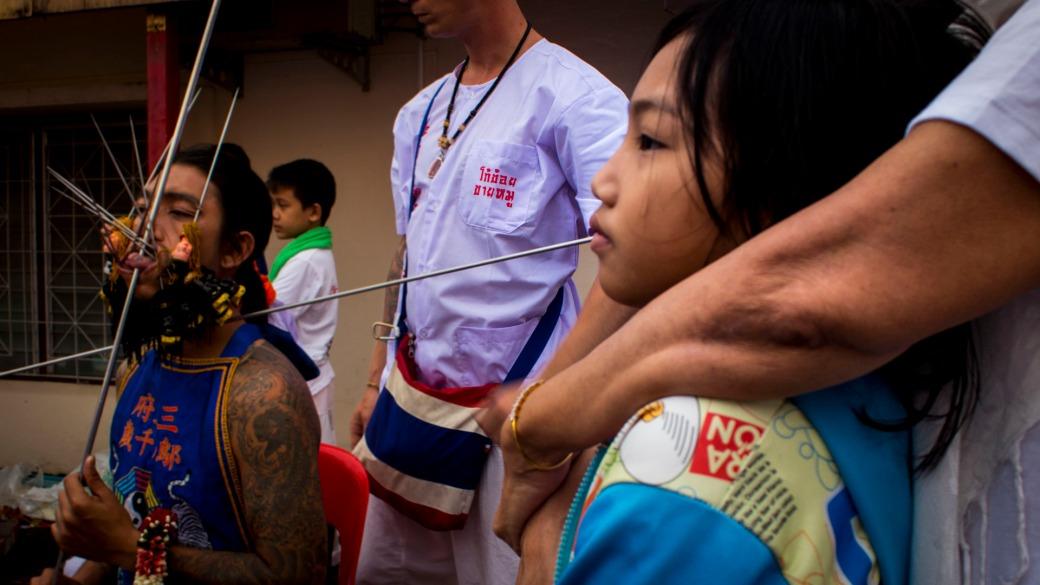 Little Girl Watches Ceremony at the Vegetarian Festival Phuket