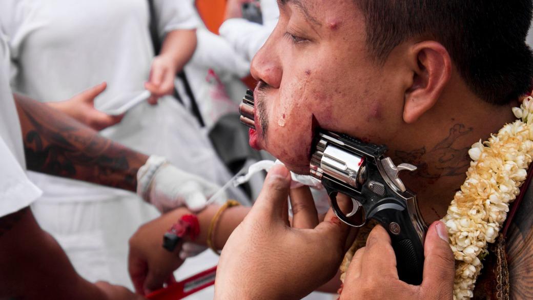 Man has face pierced with gun at the Vegetarian Festival Phuket