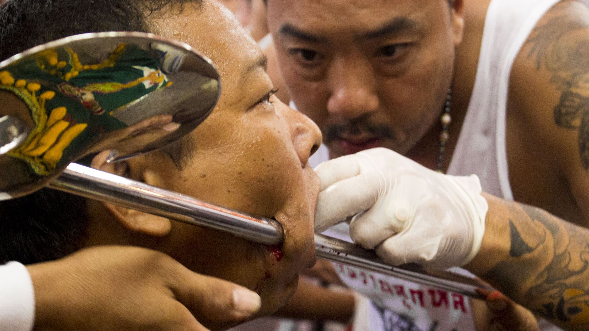 Man has his face pierced in the temple - Vegetarian Festival Phuket