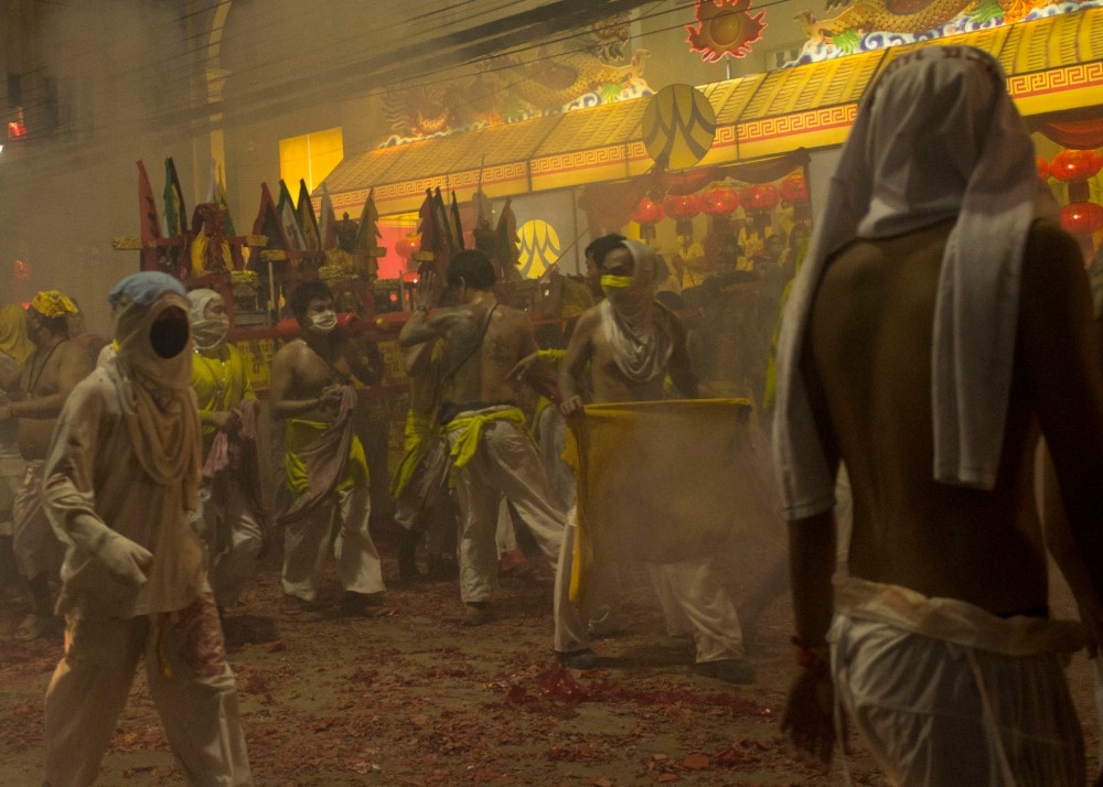 Procession through the smoke - Vegetarian Festival Phuket