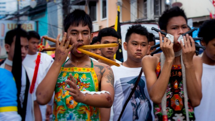 TheProcession of devotees at the Vegetarian Festival, Phuket